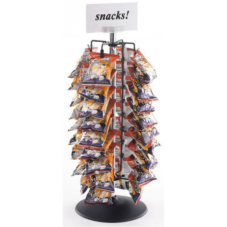 Rotating metal retail store display fixture for snacks
